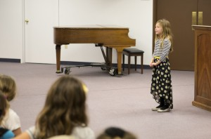 """Abigail Avila, a second grade student, presents her poem called, """"Bugs"""", Jan. 26."""
